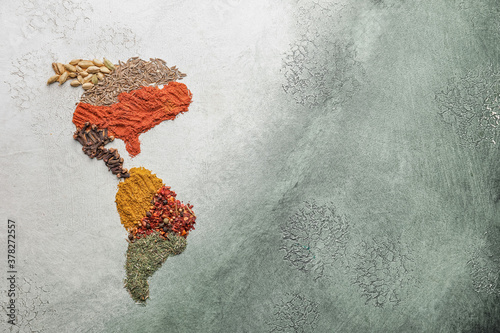Fototapeta North and South America made of spices on color background obraz
