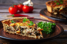 French Quiche With Chicken And Mushrooms On Wooden Background