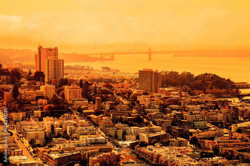 Fototapeta foggy orange sky of San Francisco skyline. California fires in United States of America. Composition about wildfires and climate change concepts.