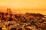 Fototapeta Kawa jest smaczna - foggy orange sky of San Francisco skyline. California fires in United States of America. Composition about wildfires and climate change concepts.