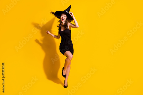 Fototapeta Full length body size view of her she nice attractive pretty slender thin cheerful cheery lady dancing having fun festal occasion event isolated bright vivid shine vibrant yellow color background obraz