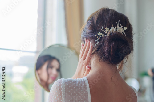 Close-up of a beautyful wedding hairstyle with hair decoration