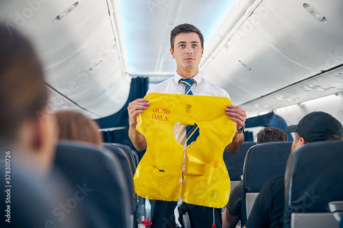 Tela Steward demonstrating airplane rules for safety on board
