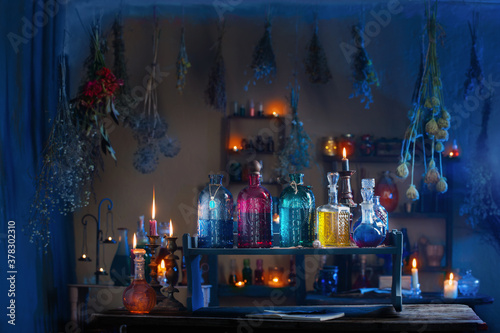 Fotografie, Obraz magic potions in witch's house with burning candles at night