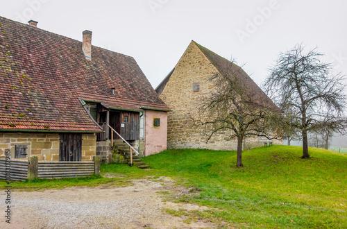 Fotografiet old farmhouse at autumn time