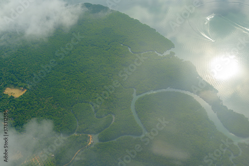 Fototapeta Aerial view photo from airplane of tropical island and turquoise clear ocean. obraz