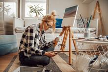 Beautiful Artist Woman Paintin...