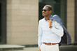 canvas print picture - handsome adult african man in shirt wearing sunglasses