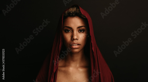 Fototapeta African american woman with traditional cloth over her head obraz