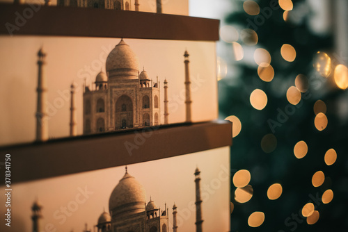 Closeup of stacked boxes printed with the Taj Majal mausoleum and bokeh lights i Canvas Print