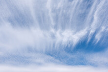 Long White Wisps Of Clouds Flowing With A Large Rippled Cloud, Beautiful Cloud In Blue Sky