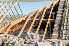Wooden Structure Of The House, Extension Of The Roof Space, Beams And Trusses, Partially Tiled, Selective Focus
