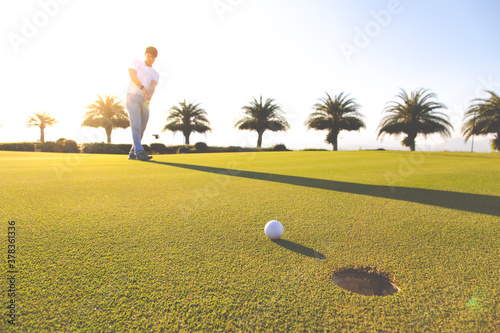 Fotografie, Obraz Golf club and ball in grass at the Golf course