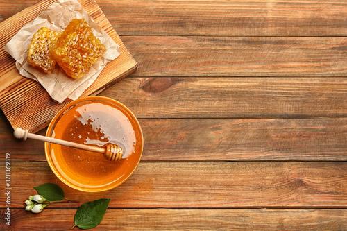 Fototapeta Fresh honey on wooden table, flat lay. Space for text obraz