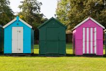 Three Colourful Wooden Beach H...