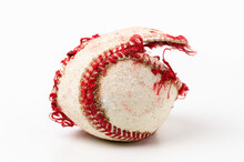 Baseball Ball That Is Ripped And Useless On White Background