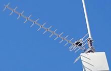 TV Antenna On A Background Sky