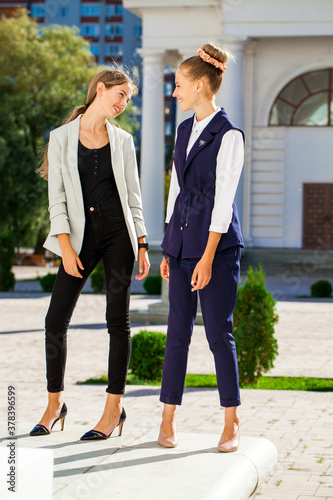 Full length portrait of two young business girls