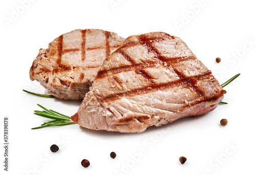 Fototapeta Two grilled tuna steak with rosemary and spices isolated on white obraz