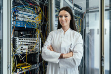 Young Woman With Arms Crossed Standing In Data Center