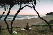Young Woman Meditating While S...