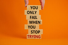 Concept Of Building Success Foundation. Men Hand Put Wooden Blocks On The Stack Of Wooden Blocks. Text 'you Only Fail When You Stop Trying'. Beautiful Orange Background, Copy Space.