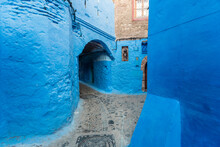 Alley At Houses Painted In Blu...