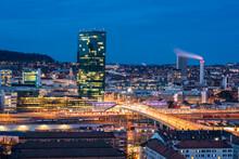 Switzerland, Zurich, Cityscape With Prime Tower And Hard Bridge Illuminated At Night