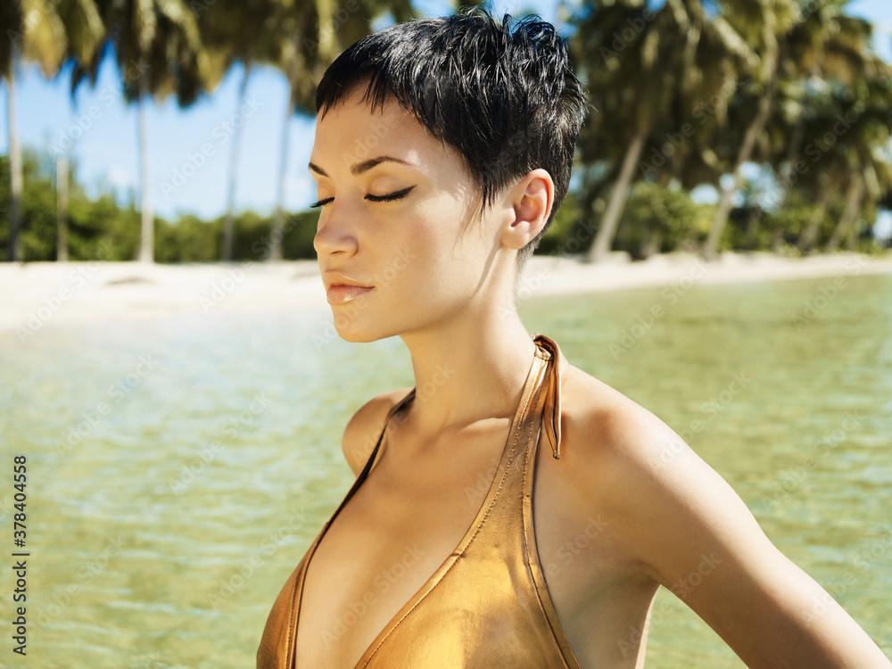Fototapeta Photo of beautiful elegant woman swiming  in the sea.