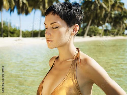 Fototapeta Photo of beautiful elegant woman swiming  in the sea. obraz