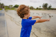 Boy Playing On The Beach At Si...