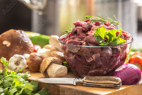 Vászonkép Sliced deer meat prepared for stew of game forest mushrooms herbs vegetables and