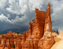 Thunderstorm Coming In Bryce Canyon National Park With A Sunlit Hoodoo Rock Formation, Utah, United States Of America (USA).