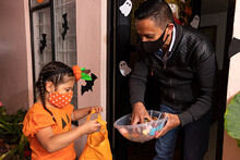 A Man Giving Candies To A Girl