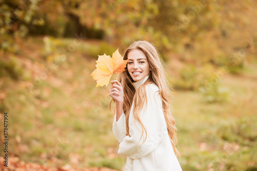 Fototapeta Curly cute girl in good mood posing in autumn day, enjoying good weather