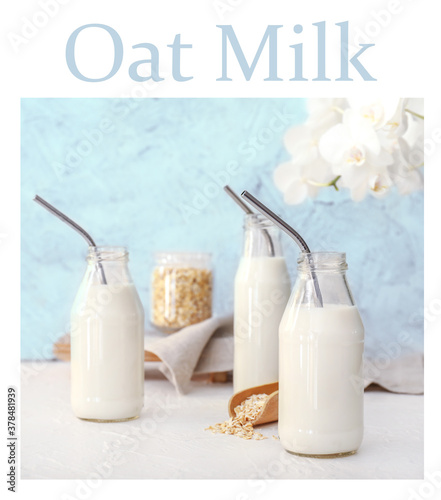 Fototapeta Bottles of tasty oat milk on table obraz