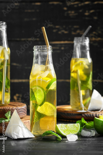 Fototapeta Bottles of fresh ice tea on dark background obraz