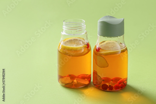 Fototapeta Bottles of fresh ice tea on color background obraz
