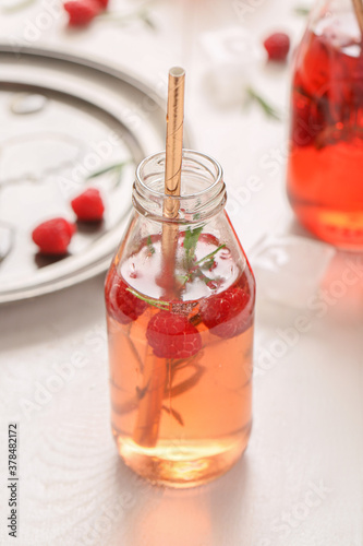 Fototapeta Bottle of fresh ice tea on table obraz