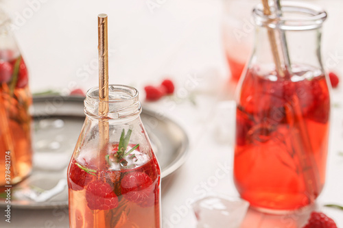 Fototapeta Bottles of fresh ice tea on table obraz