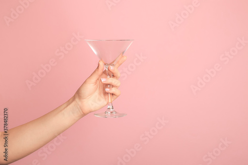 Fototapeta Hand with empty glass on color background obraz