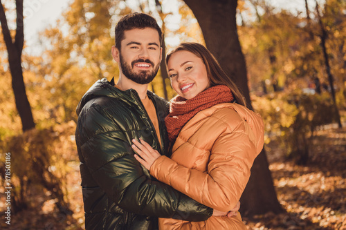 Photo of affectionate bonding couple guy hug his girlfriend in autumn outside to Wallpaper Mural