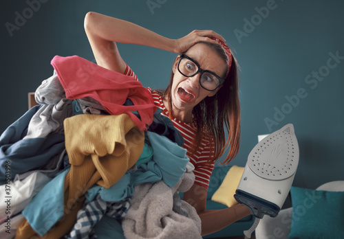 Fotografie, Obraz Frustrated housewife ironing clothes