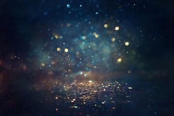 Fototapeta Formuła 1 background of abstract glitter lights. gold, blue and black. de focused