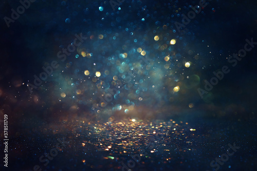 background of abstract glitter lights. gold, blue and black. de focused - 378511709