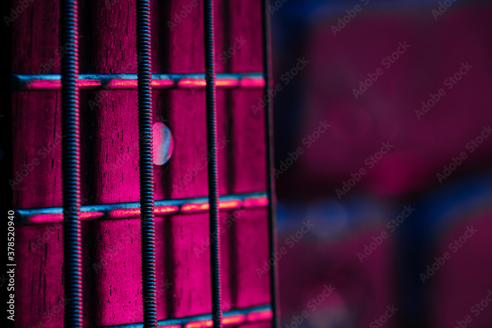Fototapeta Guitar fingerboard with strings close up photo