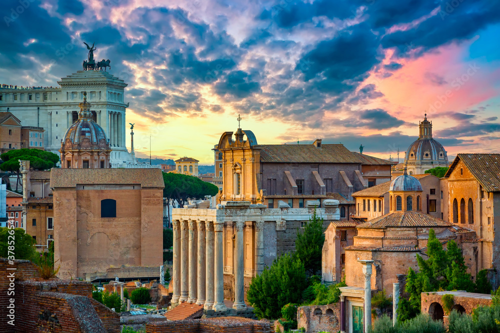 Fototapeta Aerial panoramic cityscape view of the Roman Forum and Roman Altar of the Fatherland in Rome, Italy. World famous landmarks in Italy during summer sunset