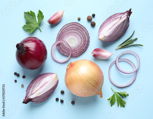 Fototapeta Flat lay composition with onion and spices on light blue background obraz