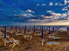 Empty Umbrellas At Sunset On T...
