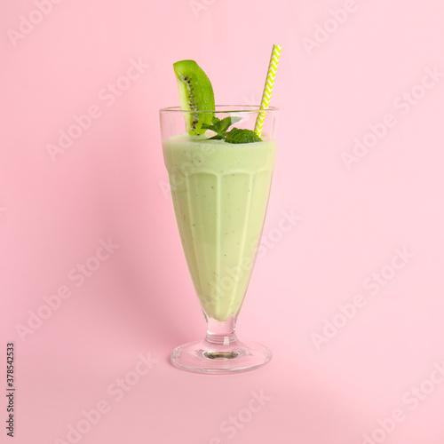Fototapeta Tasty fresh milk shake with kiwi on pink background obraz